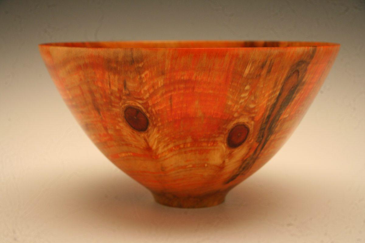 Dyed orange bowl